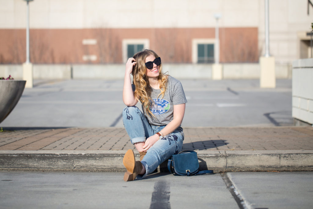 Trendy Denim, Anthropologie Pilcro Em High Rise Boyfriend Jeans, J.Crew French Travel Logo T-shirt, Treasure & Bond Winsor Block Heel Bootie, Ivanka Trump Saddle Bag, Le Specs Air Heart Sunglasses, Edgy Denim