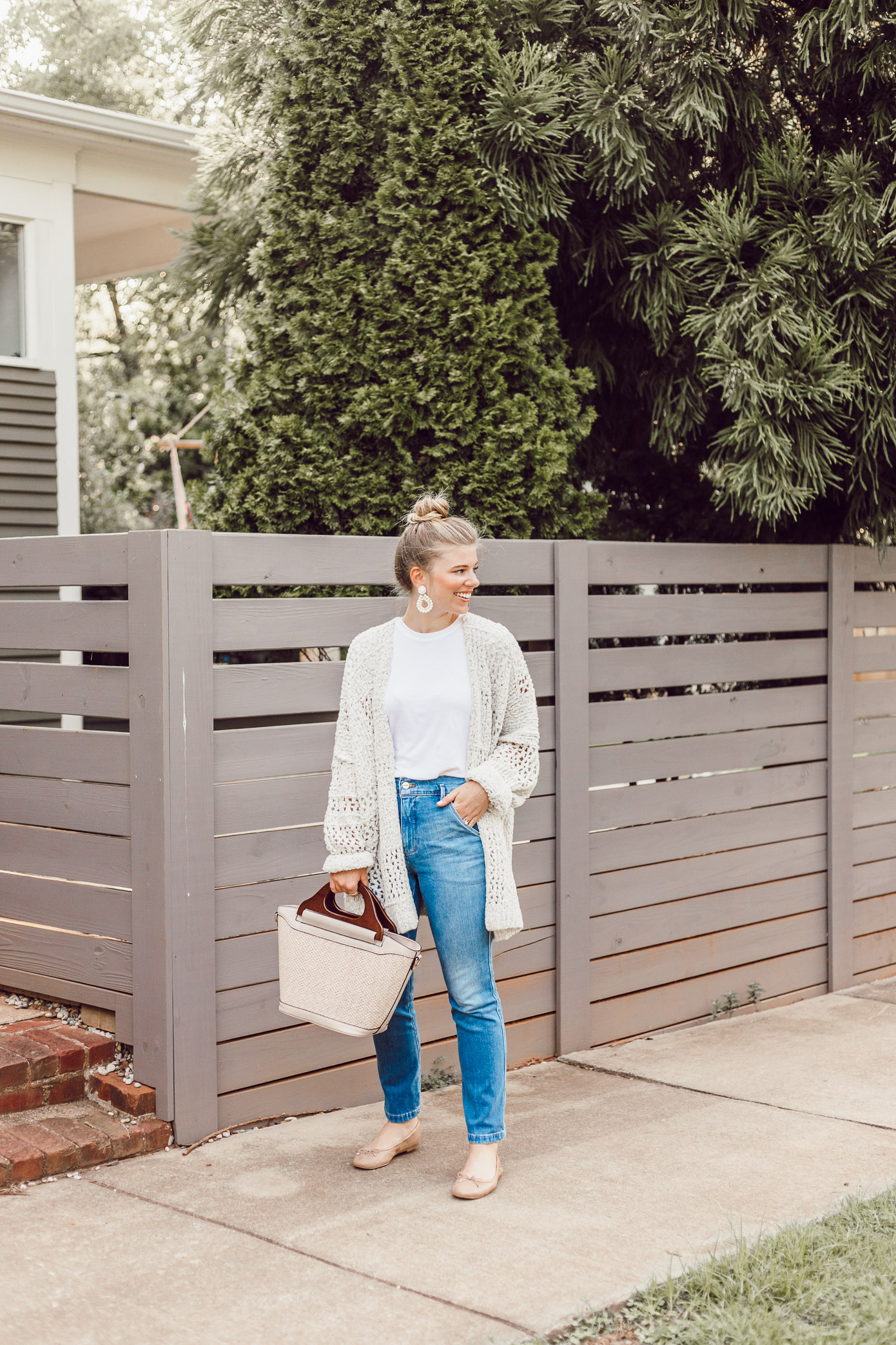 Laura Leigh of Louella Reese styles a basic white tee and jeans combination for summer that will transition perfectly into fall with the addition of a Free People Crochet Cardigan