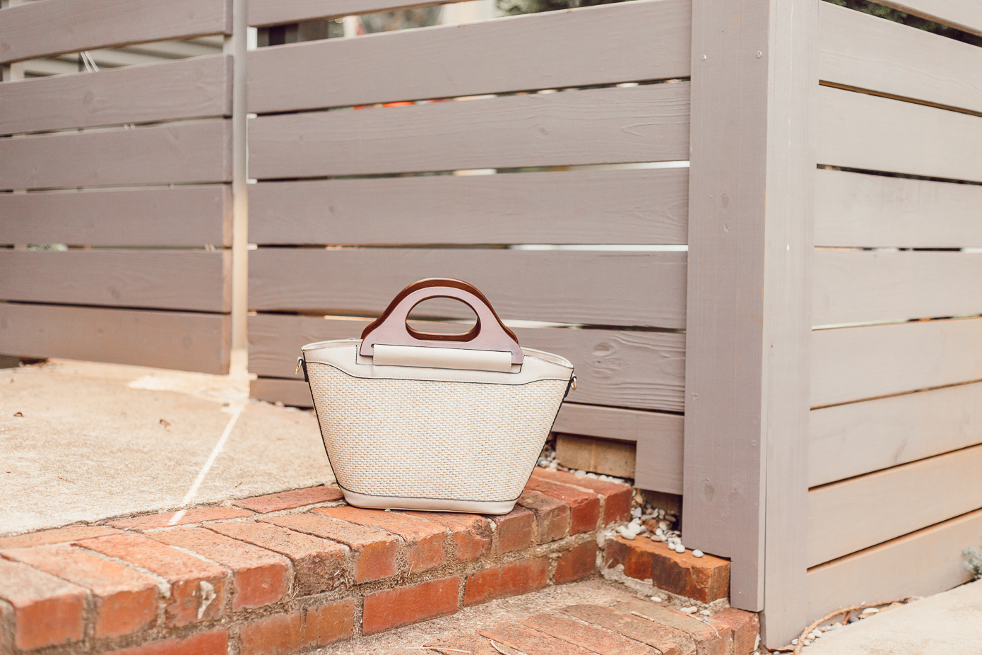 Wooden Handle Rattan Handbag | Summer to Fall Transition Handbag featured on Louella Reese