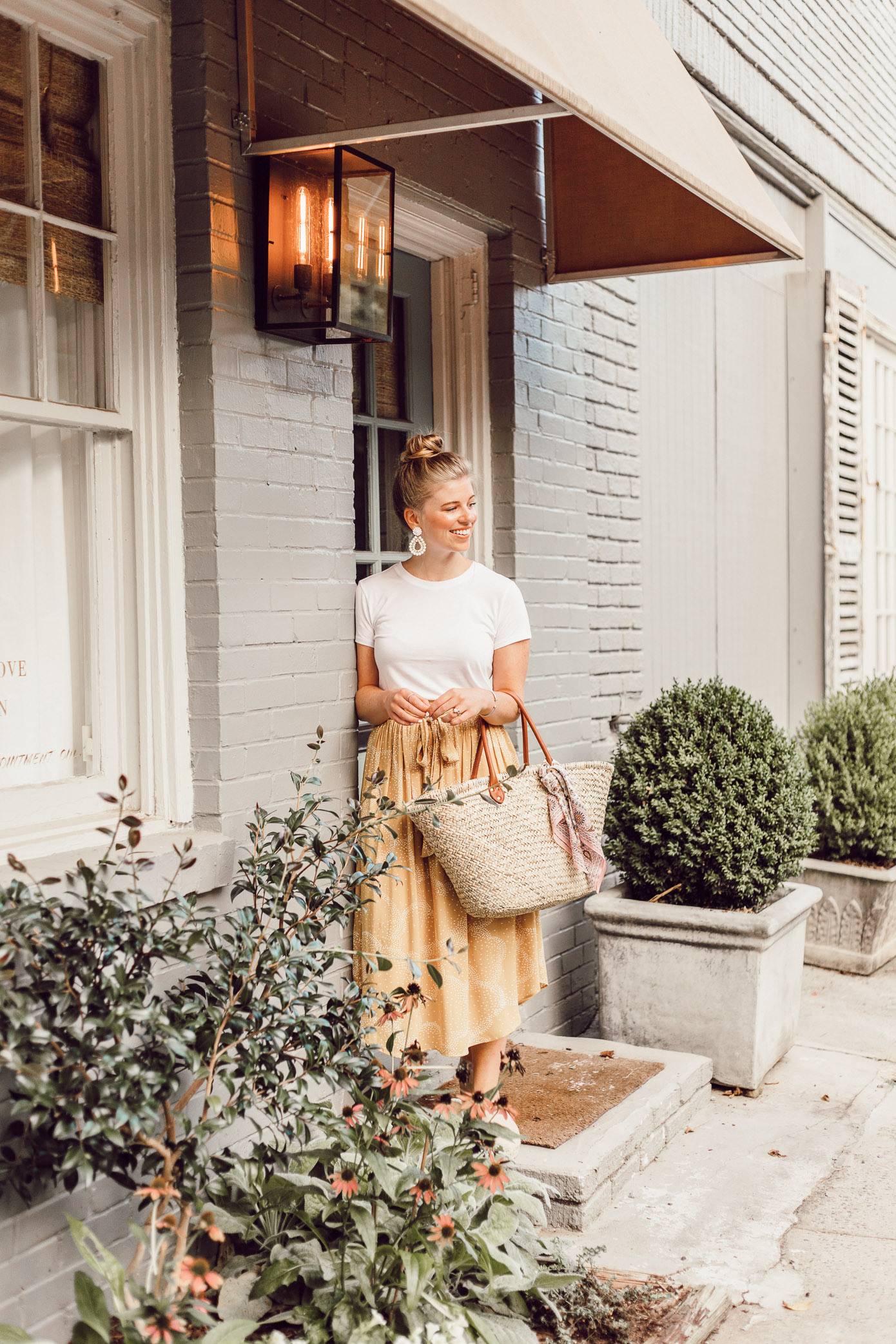 Step Out of Your Color Comfort Zone | Yellow Midi Skirt, Straw Basket Bag styled on Louella Reese