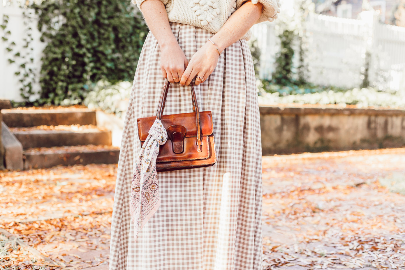 Spice Up Your Winter Date Night Look with a Winter Maxi Skirt featured on Louella Reese | Gingham Maxi Skirt, Cognac Leather Handbag