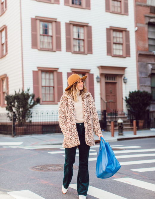 Winter Wardrobe Basics | Retro Outfit Idea - Faux Fur Leopard Coat, Corduroy Pants, Bright Blue Leather Tote, Bronze Felt Hat, White Booties featured on Louella Reese