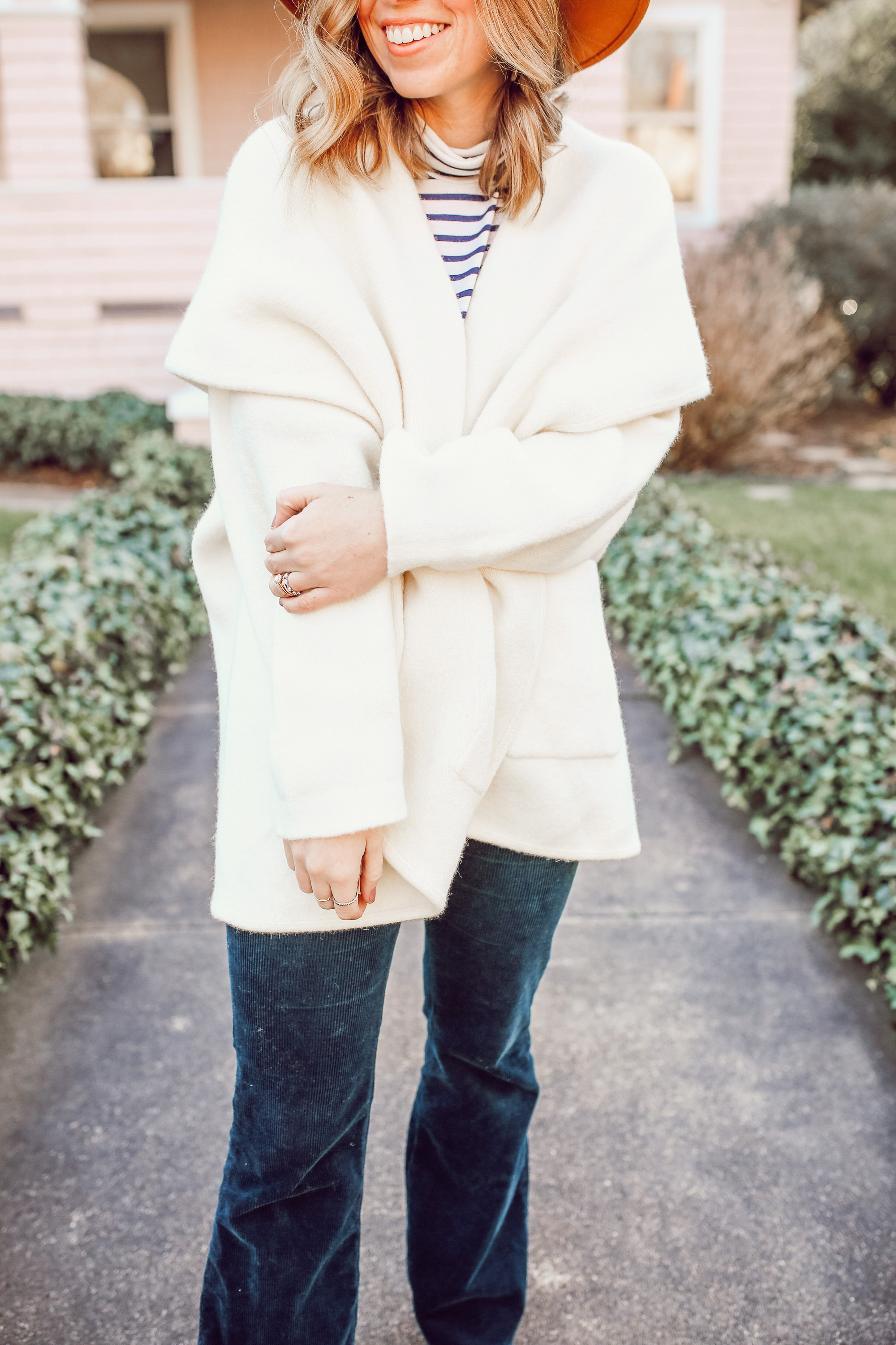 Casual Winter Uniform featured by top US fashion blogger Laura Leigh of Louella Reese; Image of woman wearing Anthropologie Hygge Cardigan, J.Crew Perfect Fit Turtleneck in Stripe, Anthropologie Corduroy Pants, Free People Wool Hat