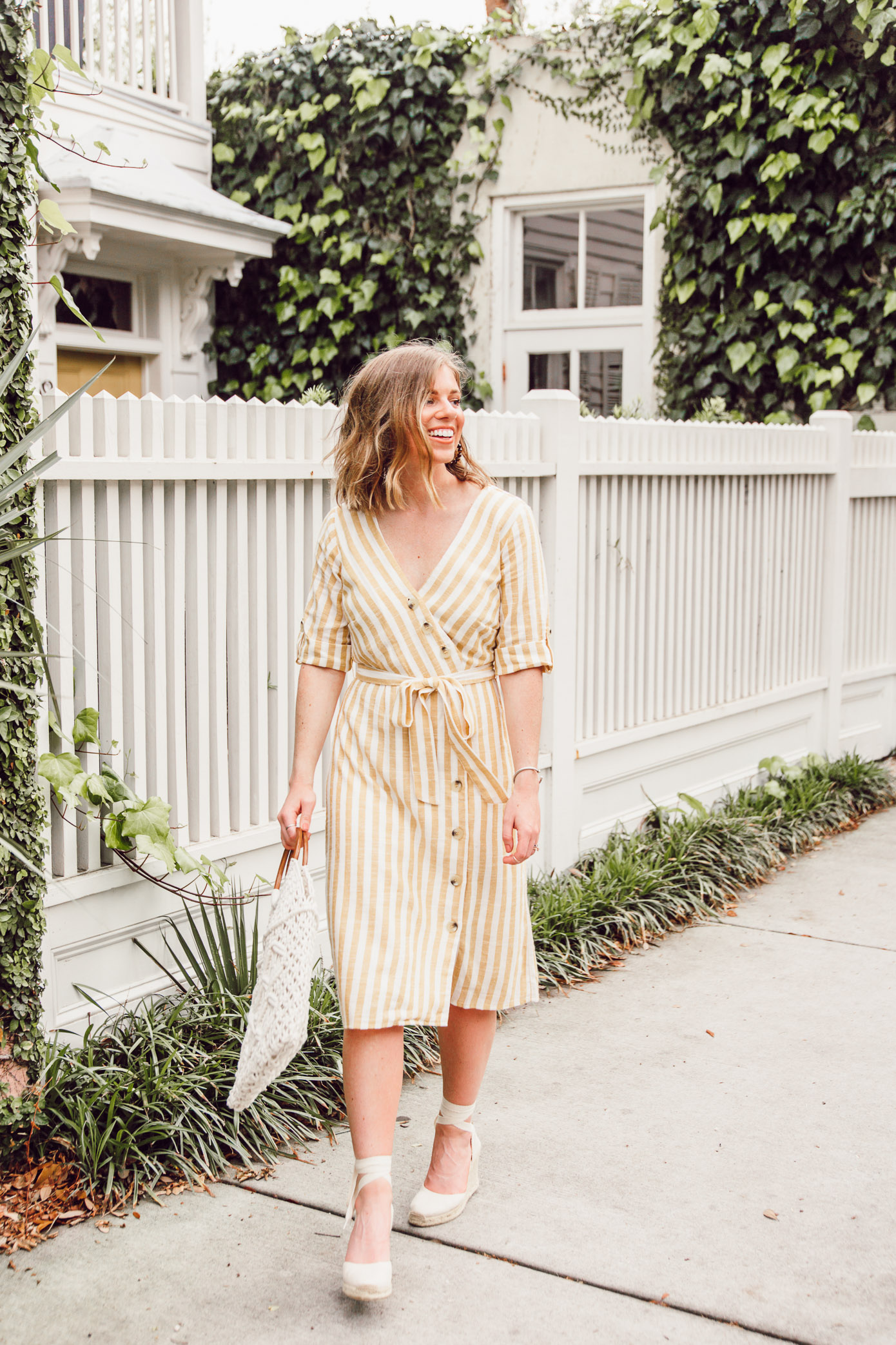 Step into spring in style in this yellow and white midi dress | Louella Reese