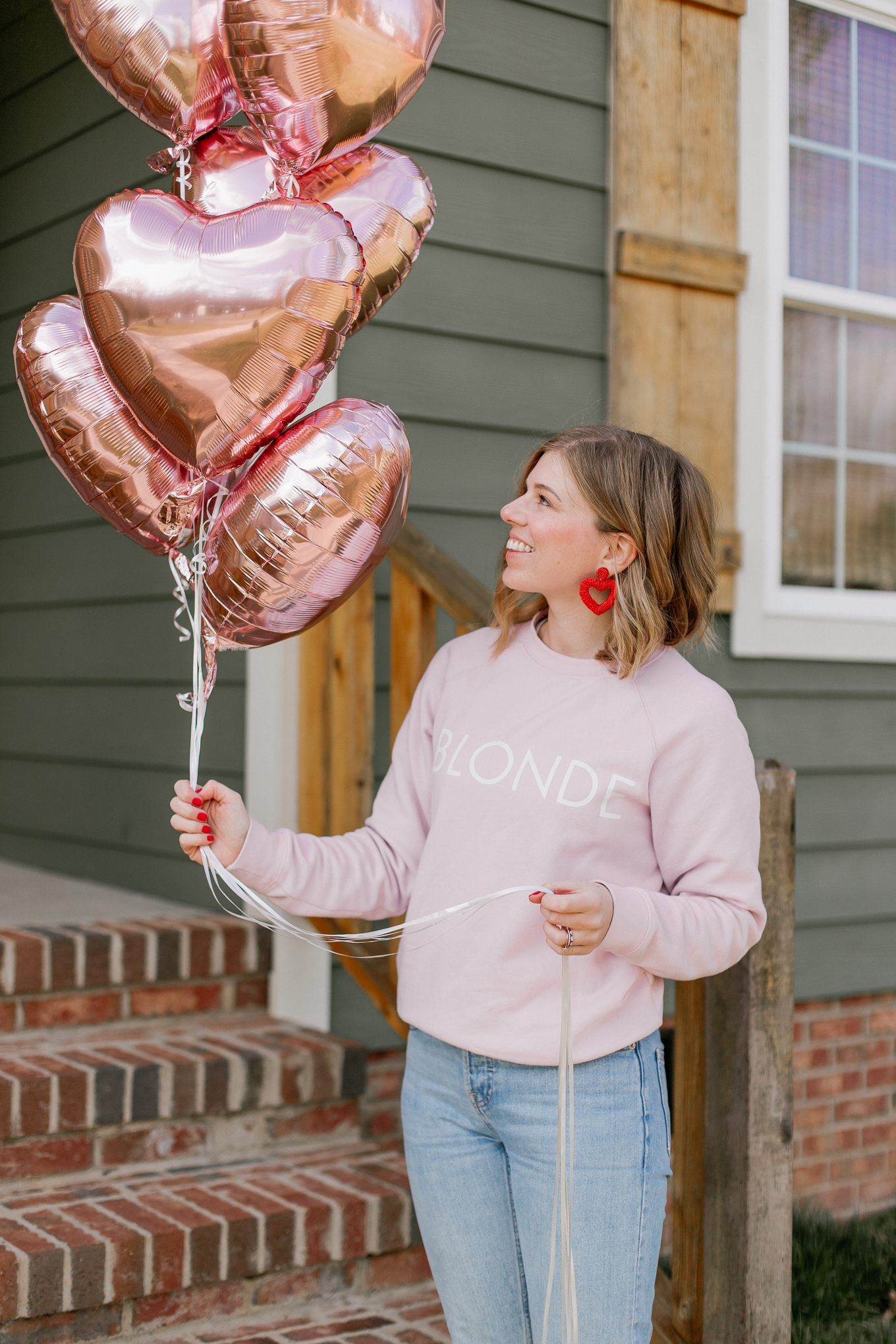 How to Celebrate Galentine's Day with your girls | Rose Gold Heart Balloons, Red Beaded Heart Earrings | Louella Reese