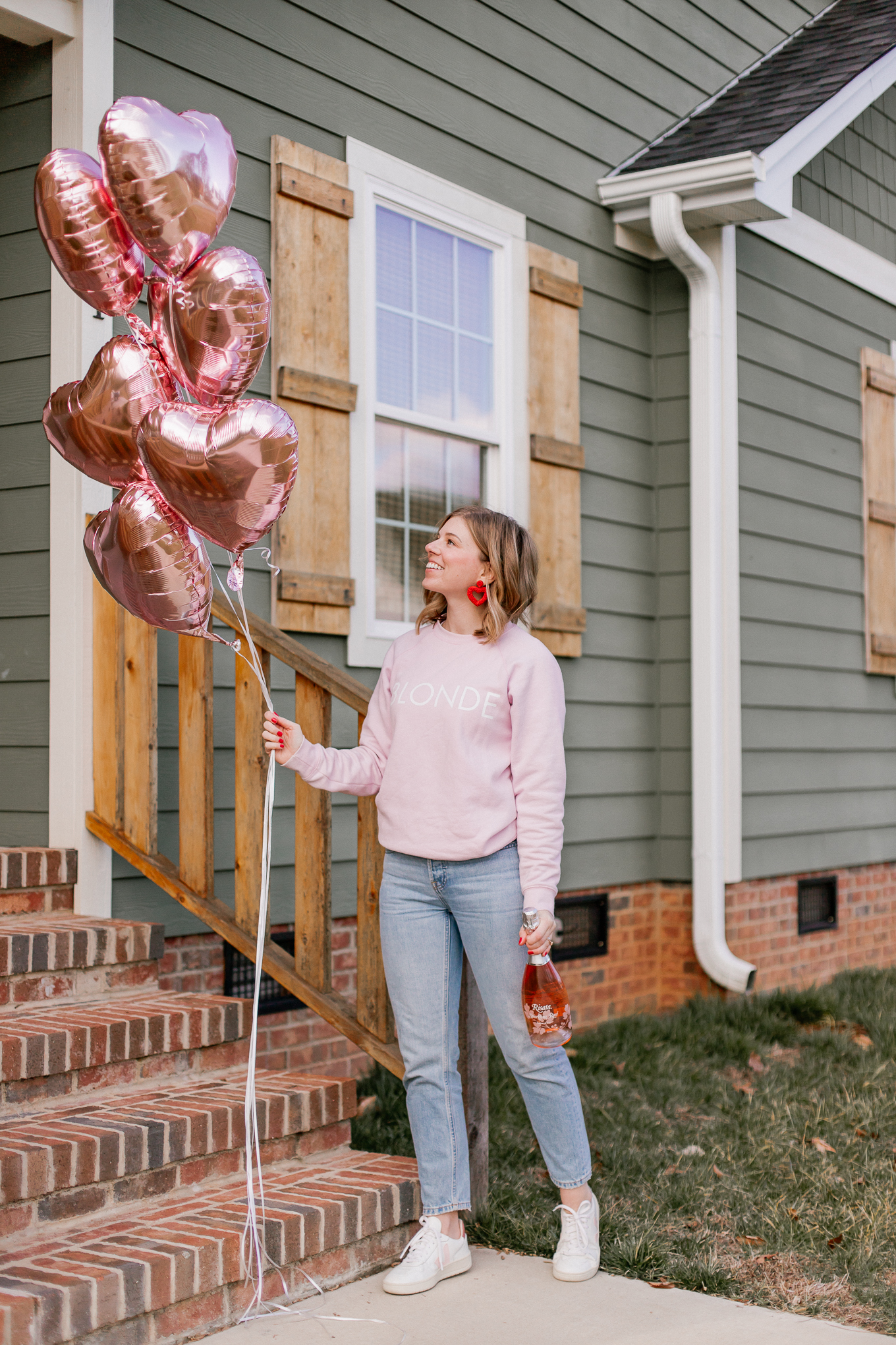 Galentine's Day Outfit Idea | Pink Crew Neck Sweatshirt, Rose Gold Balloons, Red Beaded Heart Earrings | Louella Reese